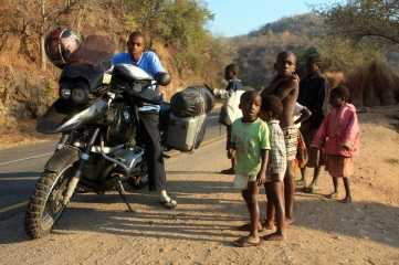 Zambian children playing with my motorbike