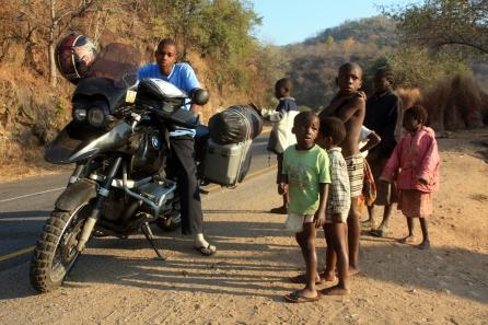 Zambian children playing with my motorbike
